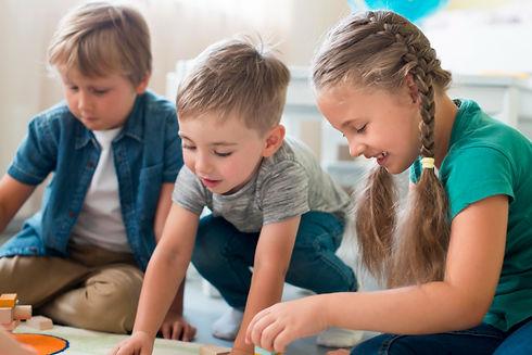 little-kids-playing-together-kindergarte
