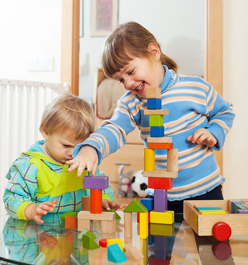 siblings-together-playing-with-toys.jpg