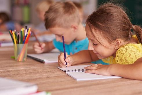little-girl-drawing-her-notebook.jpg