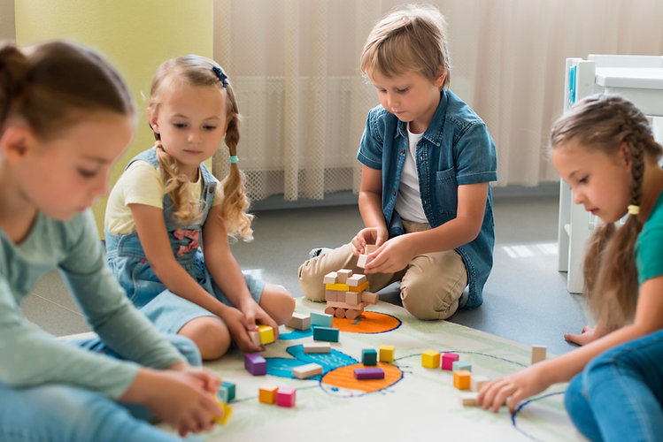 front-view-children-playing-together-kin