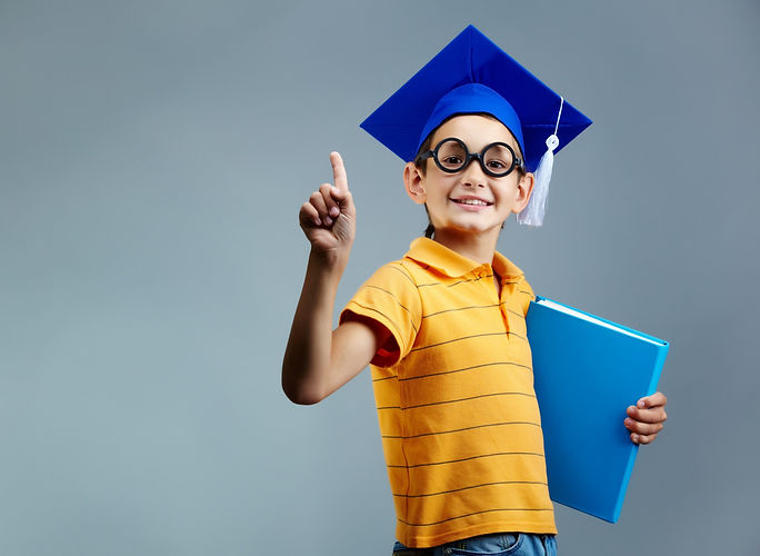 proud-little-boy-with-glasses-graduation