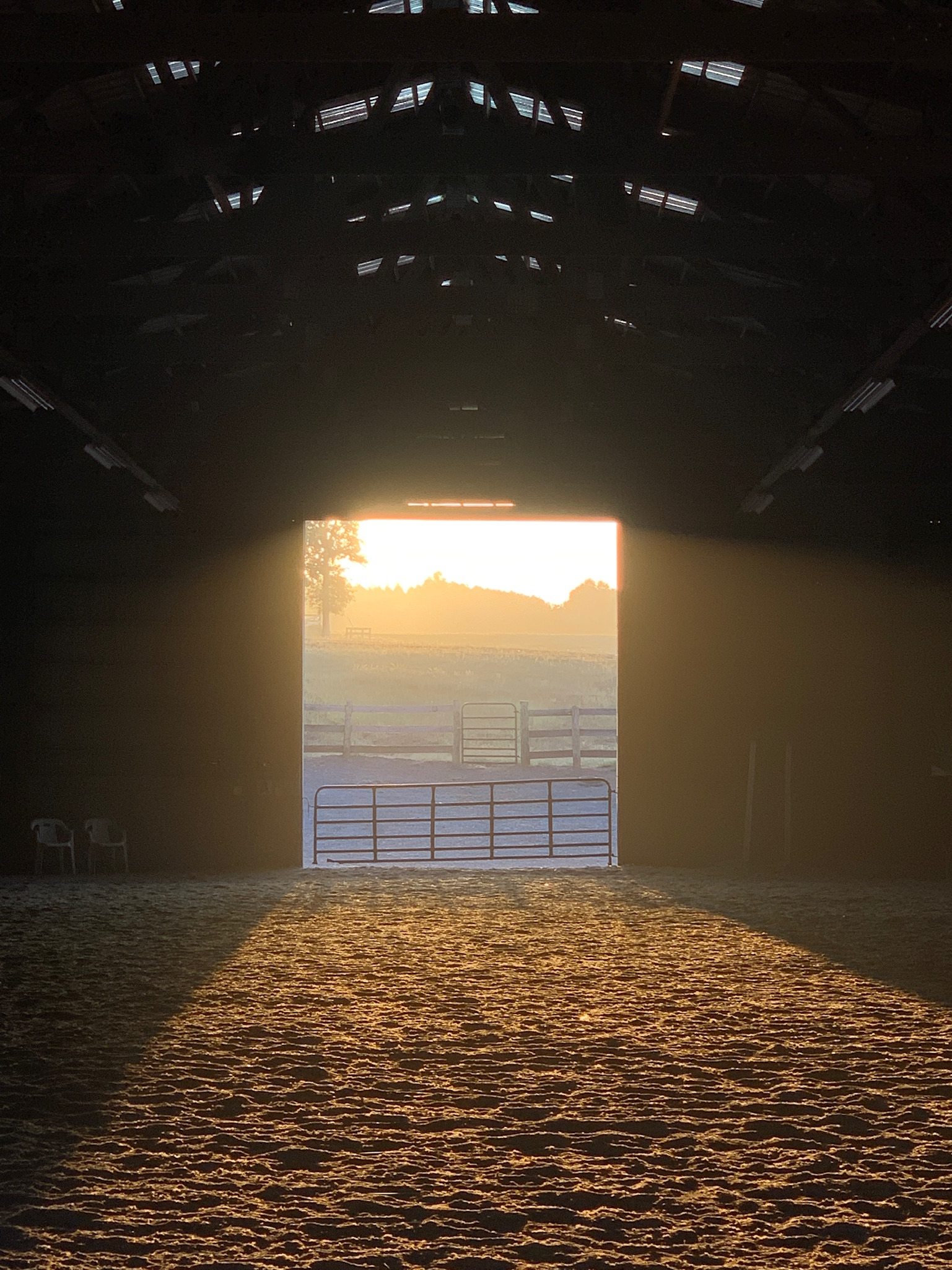 Indoor arena at sunrise.