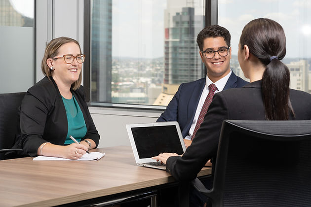 Our Service Promise Creevey Russell Lawyers Background Image of Group Talking