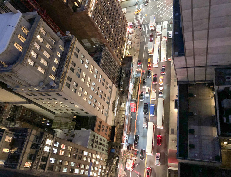 Overhead night view of city buildings