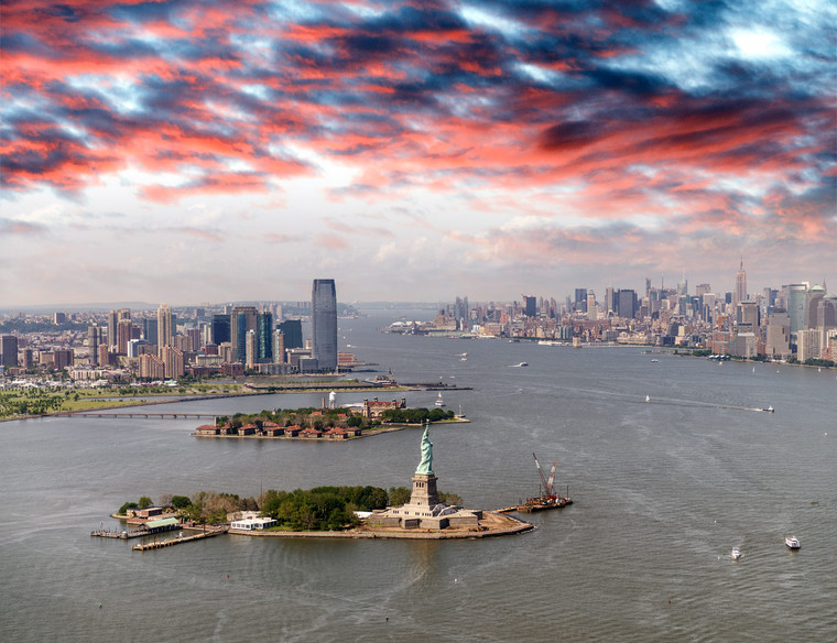 Helicopter view of Statue of Liberty, Jersey City and Manhattan