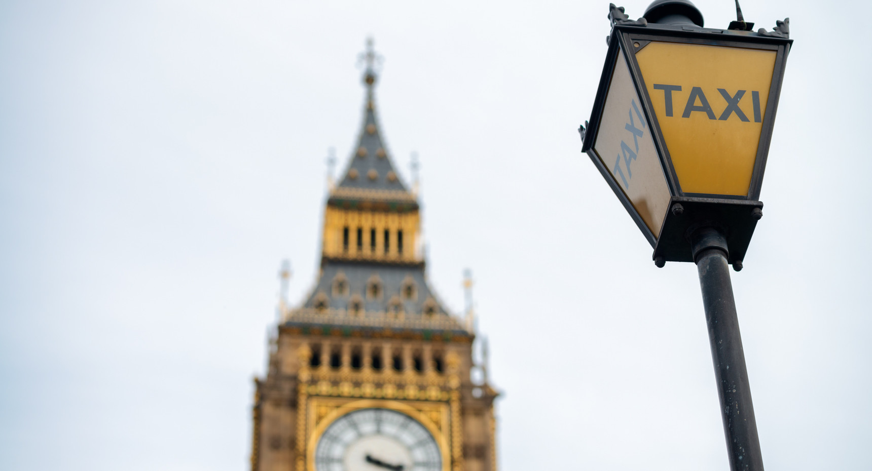 Taxi sign with Big Ben on background