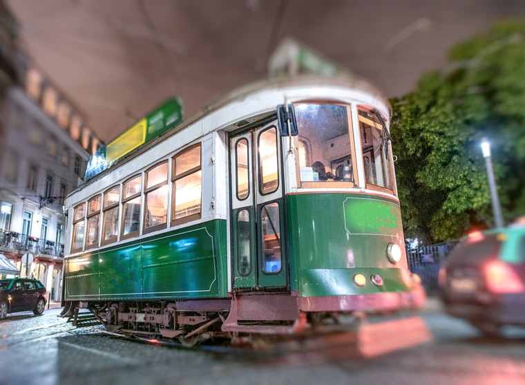 Old green city tram at night