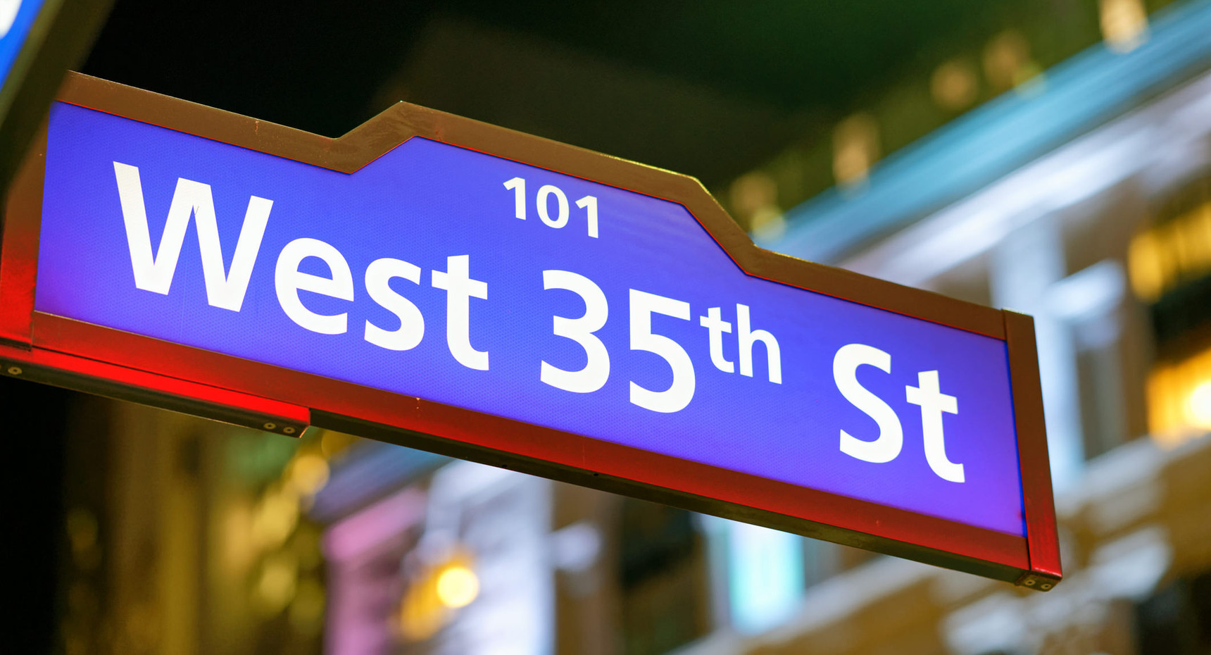 35th Street sign at night