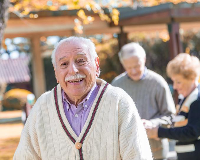 Happy elderly people enjoying life outdoor