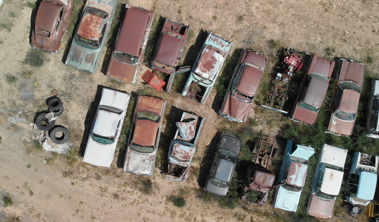 Overhead aerial view of abandoned old vintage cars, USA