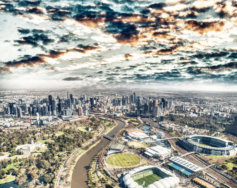 Aerial view of Melbourne skyline with river and stadiums