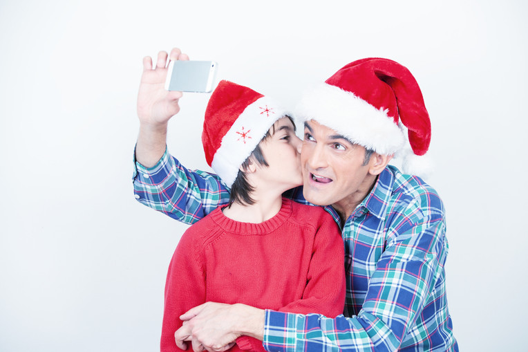 Father and son making selfie at home for Christmas