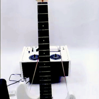 Telling - White Guitar (detail)  The White electric guitar is played by a tape loop with white reel to reel tape player, attached to guitar amplifier.