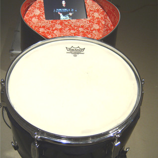 March (detail1)  Vintage Hat Box, Drum head and hardware, drum stand, LCD screen, DVD, effects pedals, amplifier, speakers