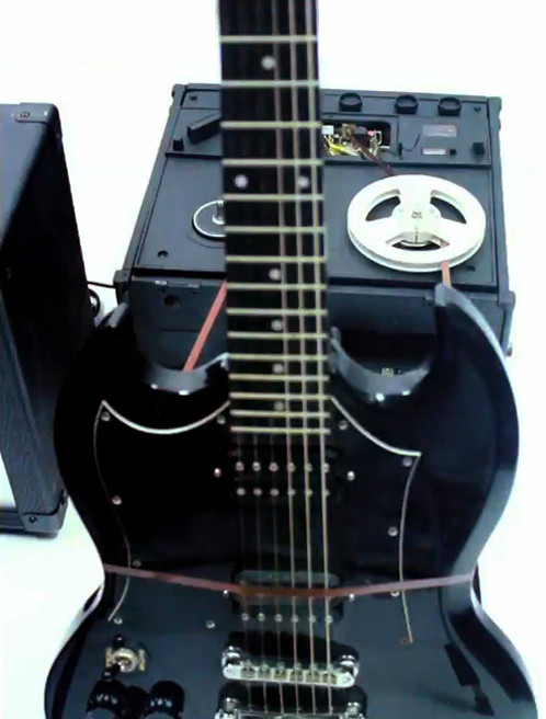 Telling - Black Guitar (detail)  The Black electric guitar is played by a tape loop with black reel to reel tape player, attached to guitar amplifier.