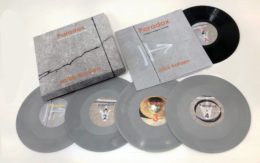 """Paradox Box Set 2019 (a study in musique concréte)  Paradox is a five-record hand-crafted box set in a limited edition of 10. Each box set contains four hand-cast playable concrete stereo 10"""", 33rpm singles and one hand- lathed vinyl 10"""" stereo EP of all four compositions- Paradox 1-4.  Paradox, a study in Musique Concréte, takes four solo instrument recordings and processes each instrument into an acousmatic composition. It features solo performances of piano, trombone, slide guitar and percussion that have each been restructured within the limitations of tape manipulation through the use of computer software.    Paradox examines the experimentation processes of Musique Concréte musically and literally through the casting of records with a fine high-tensile cement to create a playable record that reflects the spatialized sounds imbedded on it.   Available: The box set- please contact Digital version available: https://mikehansen416.bandcamp.com/album/paradox-a-study-of-musique-concrete"""