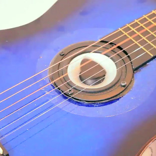 Strum 2018  Strum is part of an ongoing examination of my own desire to be a musician. I find that I can be lazy and don't want or have the time to master an instrument. My solution is to create an instrument that plays itself.  Strum is a participatory sound installation that examines music improvisation through the idea of a self-playing guitar. Strum invites the participant to strum or pluck the strings of guitar. The vibrations from this initial contact cause a feedback loop through a speaker placed in the sound hole of the acoustic guitar. The vibrations cause a guitar pick placed on the speaker below the strings to hit the strings in a random or improvised form. The playing constantly evolves as the bass feedback through the speaker forces the object placed on it to bounce against the strings in unpredictable ways. This action from the strum propels the guitar to self improvise thus composing and performing simultaneously.