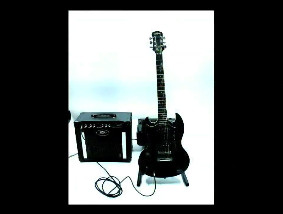 The Black Guitar is played by a tape loop with a single edit in the tape. The single edit creates a drone with a single pluck of the guitar strings as the edit passes over them.