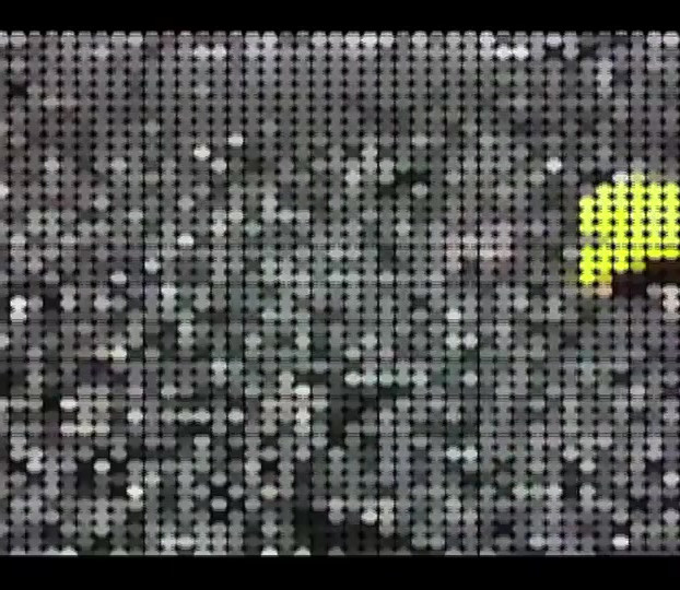 """Flotsam (Single Channel Video)  2012  3min 39 sec animated video  Flotsam is an animated video thriller, inspired by Michelangelo Antonioni's 1966 """"Blow Up"""", realized through a process of extreme pixelation. The work originated as a live action video that has been re-animated into a mass of coloured dots. Seemingly abstract, the dots articulate landscape and become visual action cues on a screen of moving coloured pixels. The narrative is conveyed through the viewers' eyes as they wander through a rocky cove in rural Newfoundland and stumble upon the unexpected."""