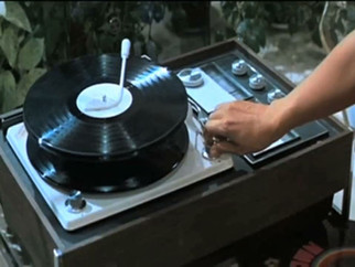 45rpm (Single Channel Video) 2014 4min 41sec  45rpm is a collage of 45 various film and television exerpts to create a compostion based on my own experimental turntabling practice.