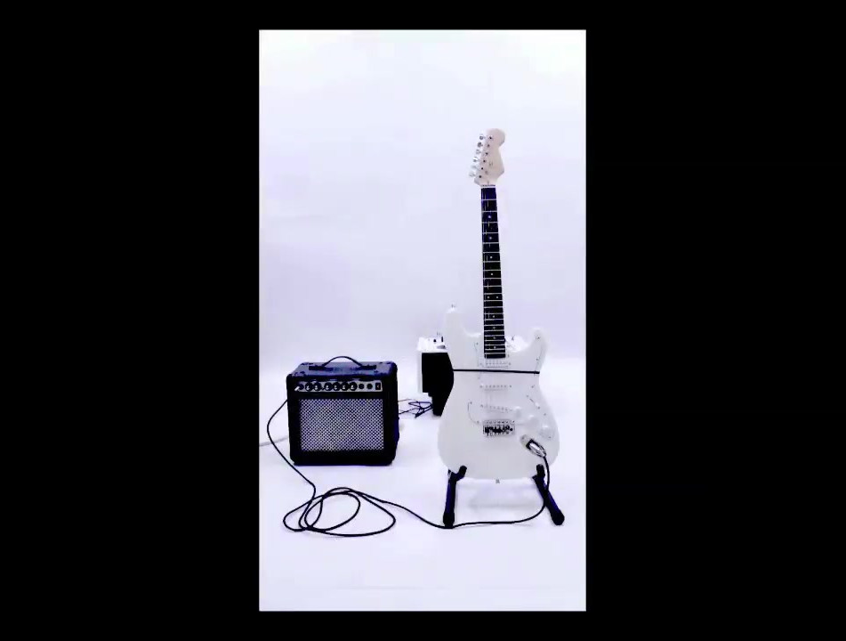 The White Guitar is played by a tape loop with a multiple edits in the tape. The multiple edits creates a a number of plucks of the guitar strings as the edits passes over them.