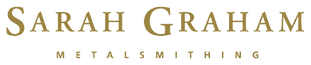 sgm_logo_gold_300ppi_edited.png