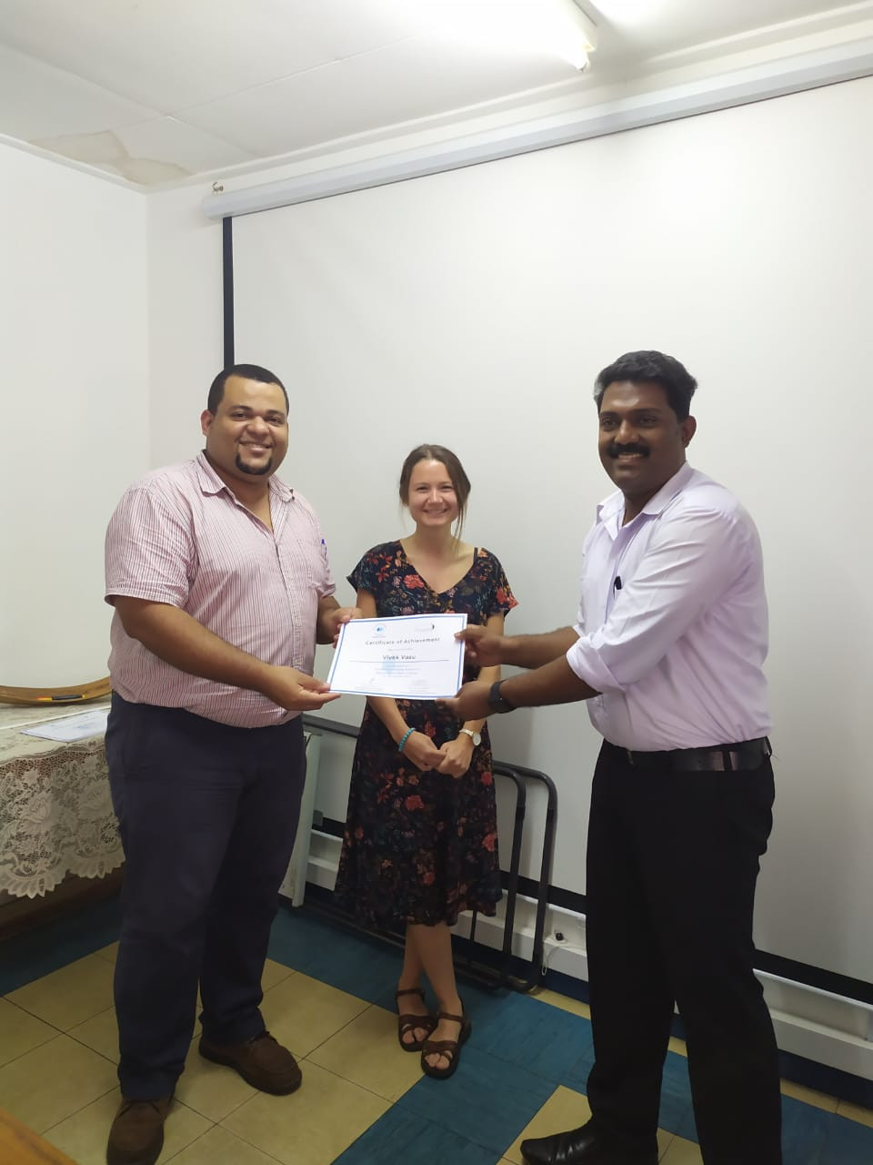 Figure 5; Mr Lesperance and Ms Mullins handing over certificate of achievement to Sir Vivek the fisheries science lecturer at SMA.