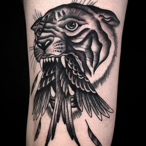 blackwork old skool tiger eating bird tattoo by Nick Rutherford at Third Eye