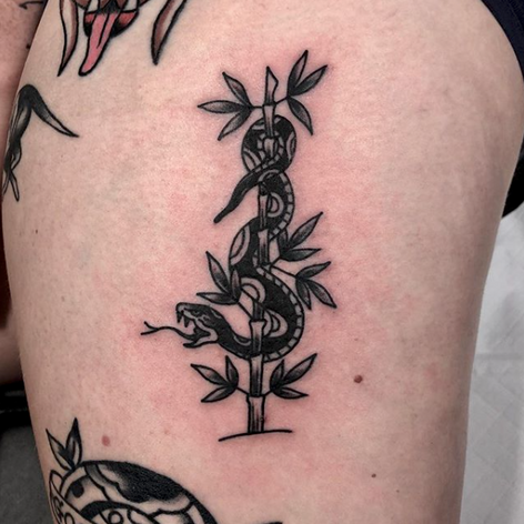blackwork walk-in snake and bamboo tattoo by Oliver Chistenson at Third Eye