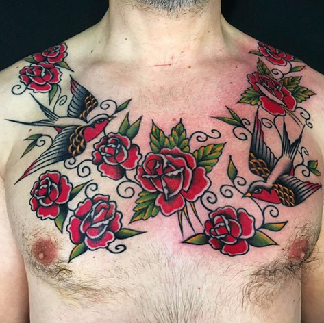 beautiful traditional roses chest tattoo by Nick Rutherford at Third Eye