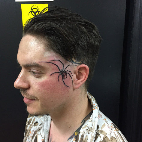 spider face tattooo by Bugsy at Third Eye Tattoo Melbourne