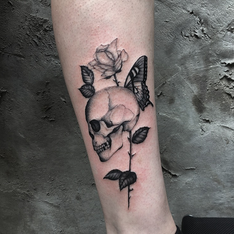 fineline dotwork skull, rose and butterfly tattoo by Daniel Snoeks at Third Eye Tattoo
