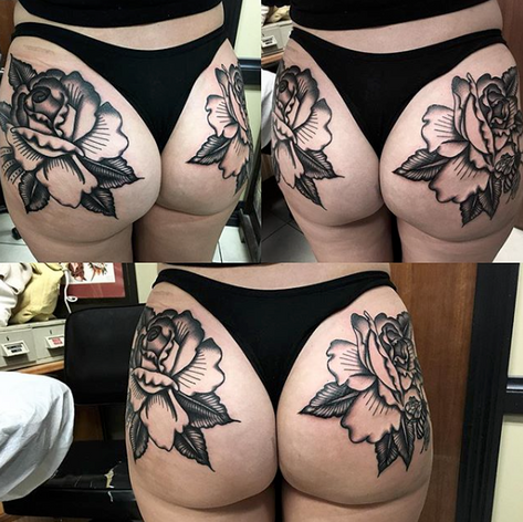 traditional blackwork roses tattoo by Nick Rutherford at Third Eye
