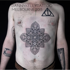 fine mandala chest tattoo by Danny Kelly at Third Eye Tattoo Melbourne