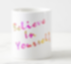 Believe in Yourself written in rainbow font on coffee mug