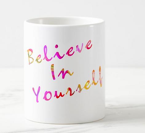 Believe in Yourself written in rainbow font on coffee mug