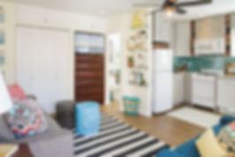 Mission Beach Studio | San Diego Small Spaces | Mission Beach Small Spaces | Danielle Interior Design and Decor | San Diego Interior Design | San Diego Interior Decorator | La Mesa Interior Design | Beach decor | Beach Theme interior | Teal back splash | Turquoise back splash | Apartment size appliances | White appliances | L Shape Kitchen | San Diego Kitchen Remodel | Small Beach getaway in San Diego | fun beach decor | Diamond Cloud cabinets | Wood vinyl flooring | Plank Vinyl flooring |