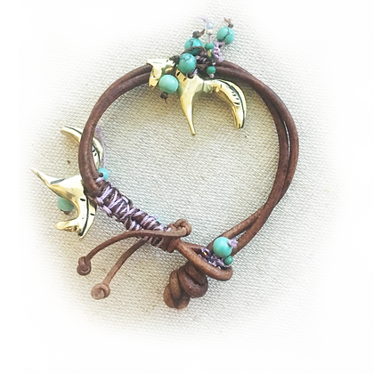 bracelet with two bronze horses on leather with beads