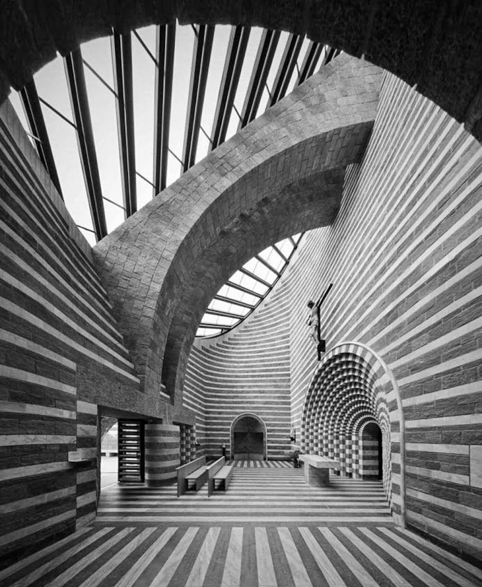 Church of San Giovanni Battista by Mario Botta. Carlo Scarpa was Botta's thesis advisor. You can clearly see Scarpa's influence in Botta's work.