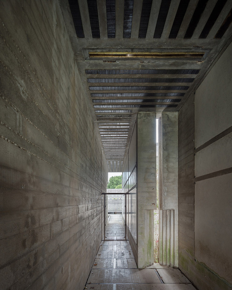 Narrow corridor leading to the floating meditation pavilion. Note the glass door blocking access. Photo ©Darren Bradley
