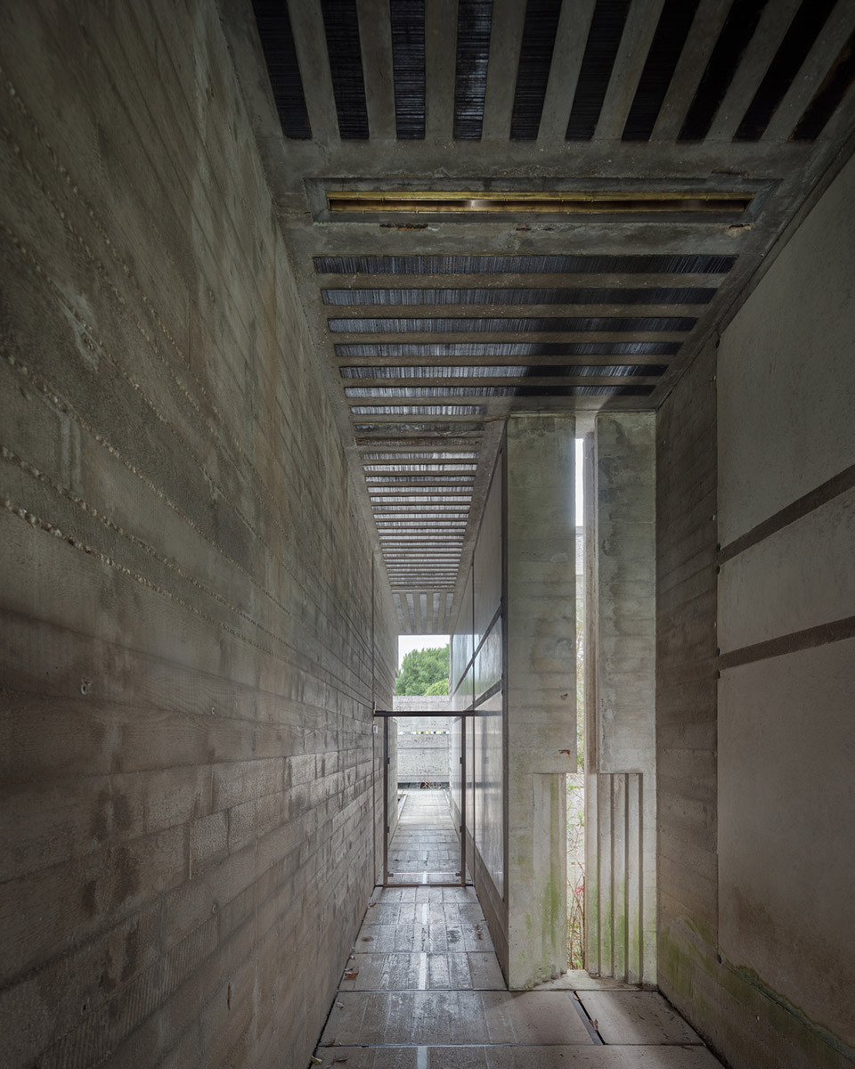 Narrow corridor leading to the floating meditation pavilion. Note the glass door blocking access. Photo ©Darren Bradley