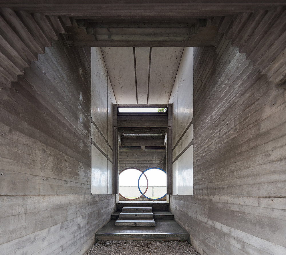 The narrow corridor is a classic example of compression and release, as well as the symbolism and contrasting materials so often present in Scarpa's work.  Photo ©Darren Bradley