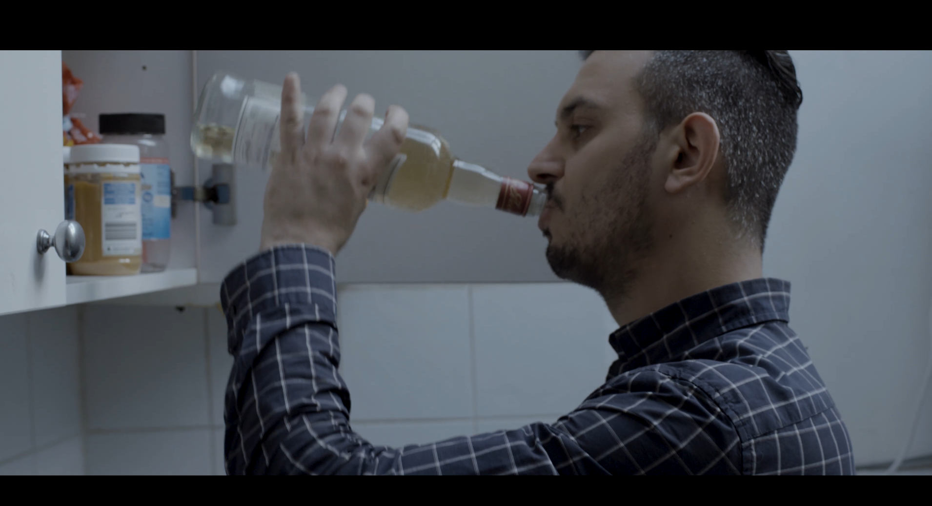 Sc3. Anthony drinking at home alone.png