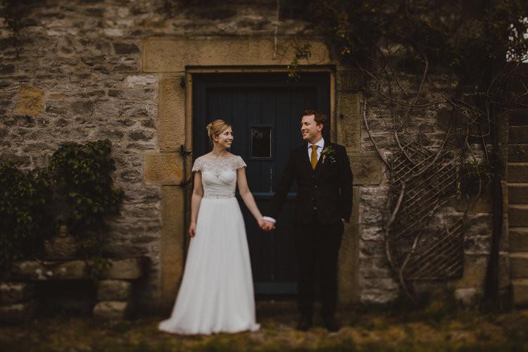 Wedding pic framed by barn door