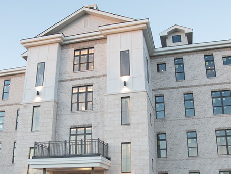 Revery Point lakefront condos at Foxland Harbor golf community near completion