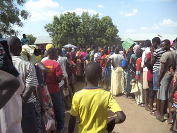 The distribution of the 40ft. container of Rice Meal (manna) in Nimule, South Sudan
