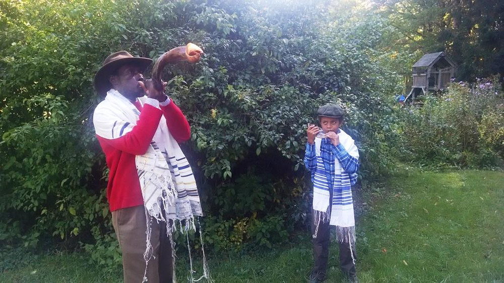 William and Nechemiah blowing shofar.jpg