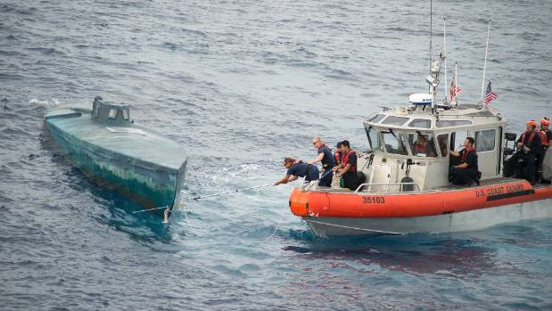 Crew from the US Coast Guard Cutter Stratton stop a Self-Propelled Semi Submersible (SPSS) off the coast of Central America. (U.S. Coast Guard photo)