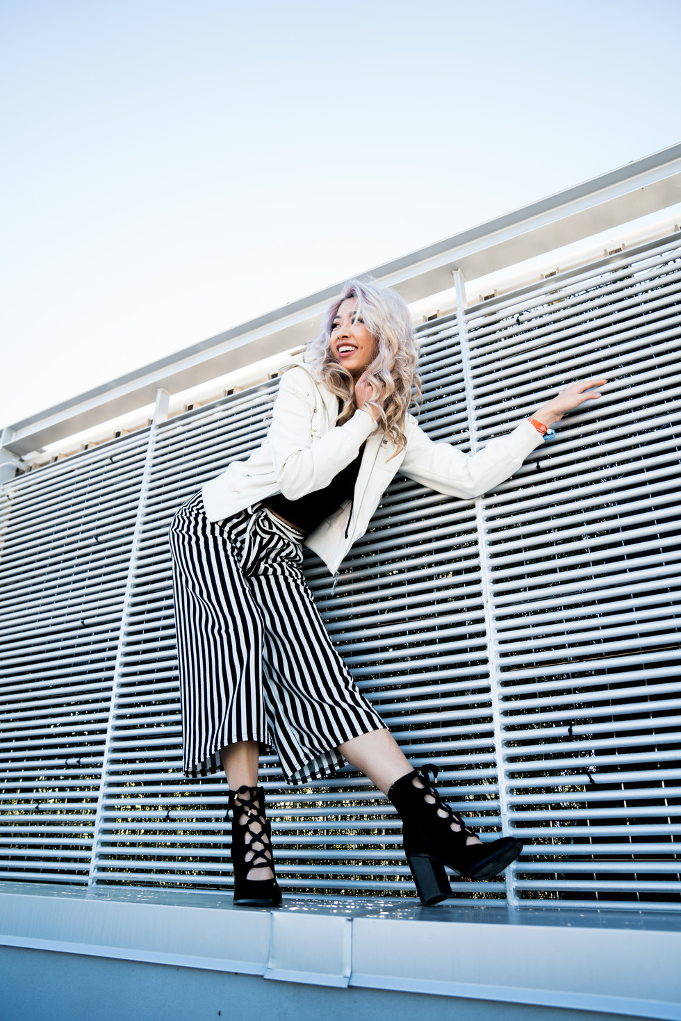 Woman Posing in Front of Fence | Portrait/Fashion Photography | Chromatone Studios