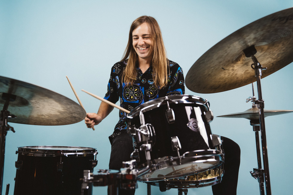Drummer on Blue Background | Portrait/Fashion Photography | Chromatone Studios